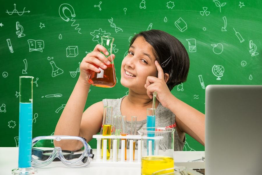 Young girl learning science from science tuition