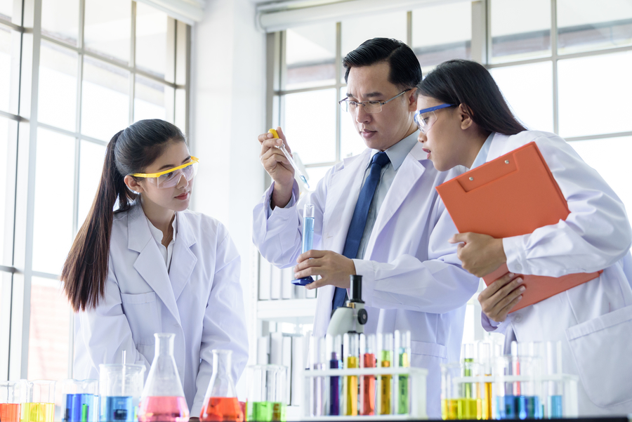 Students attending science tuition class in laboratory