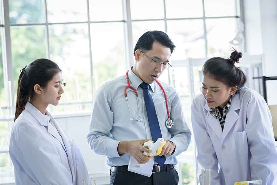 chemistry teacher showing an experiment to students