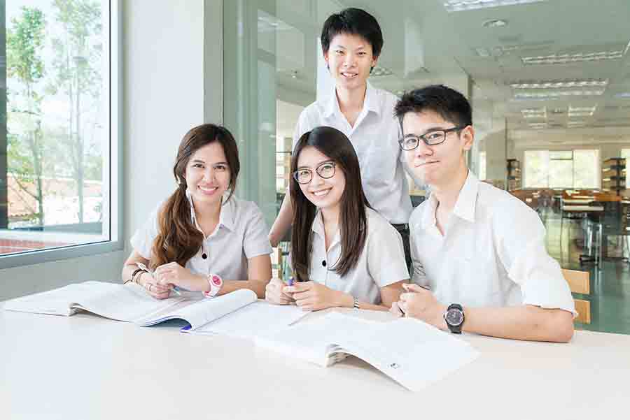 group of jc chemistry students studying together