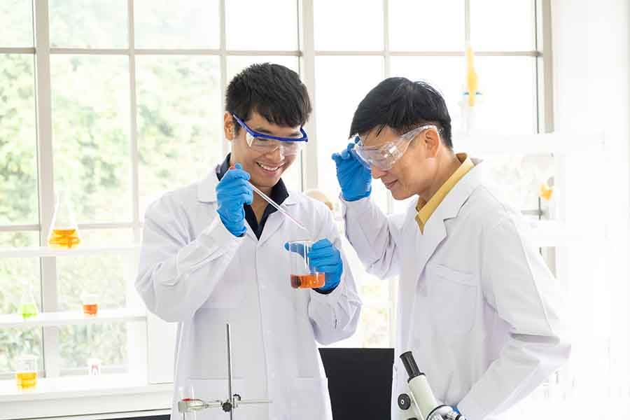 two student chemists conducting a test