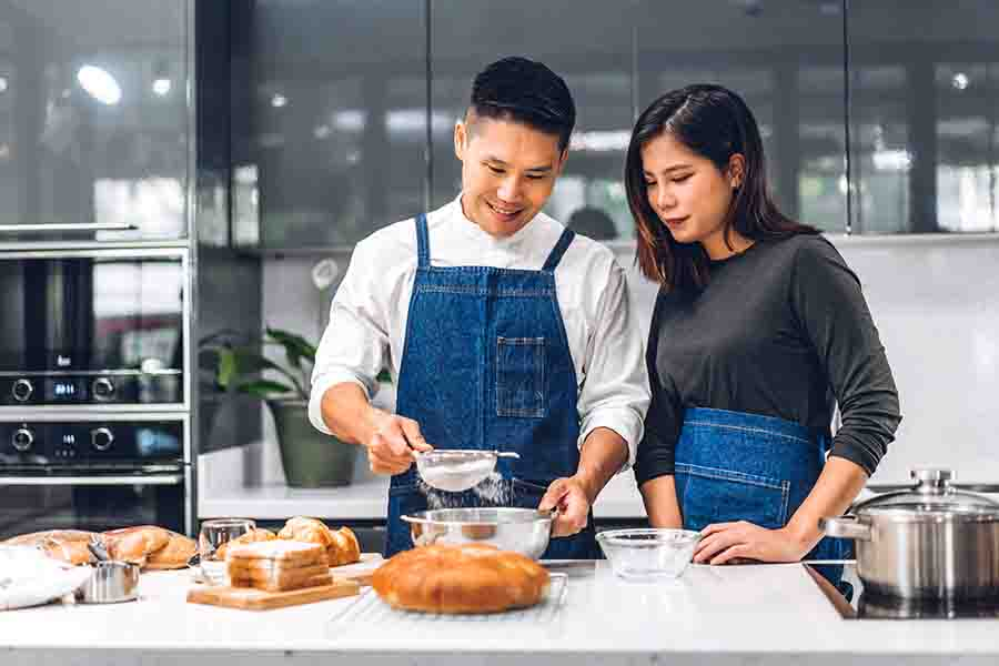 couple using chemistry to improve cooking session