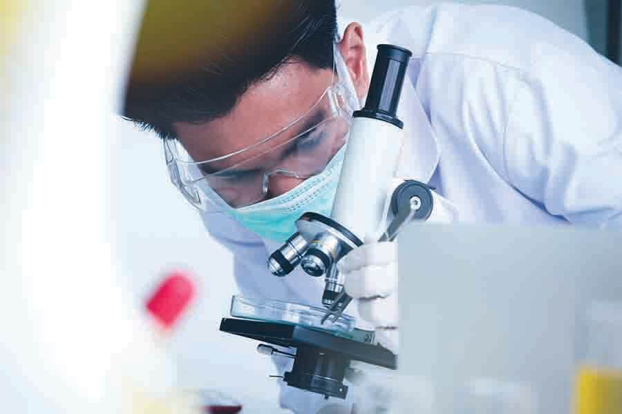 scientist using microscope to observe nano objects